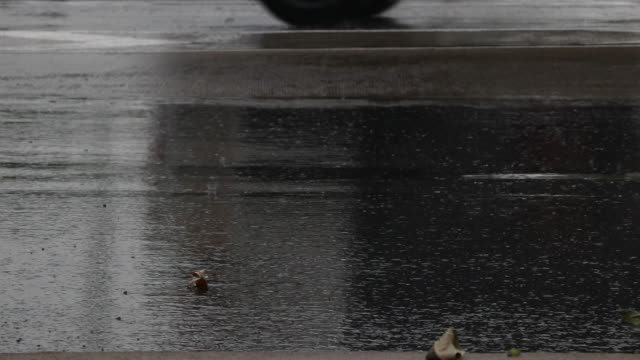 A-car-running-on-the-road-raining-should-be-careful-because-the-roads-are-slick-and-accidents-may-occur-