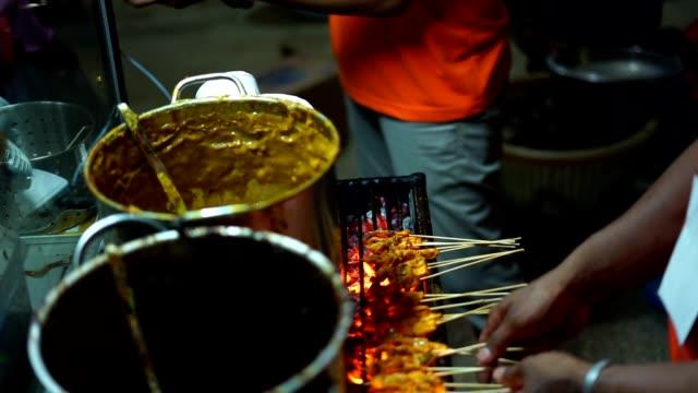 Satay-Padang-Meat-skewers-cook-over-hot-coals-at-Indonesian-Street-food-market