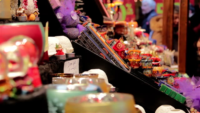Shoppers-Buying-Gifts-at-German-Christmas-Market-Toy-Stall---Twinkling-Lights