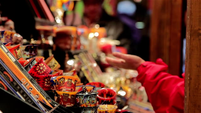 Shoppers-Exchange-Money-at-German-Christmas-Market-Toy-Stall---Twinkling-Lights