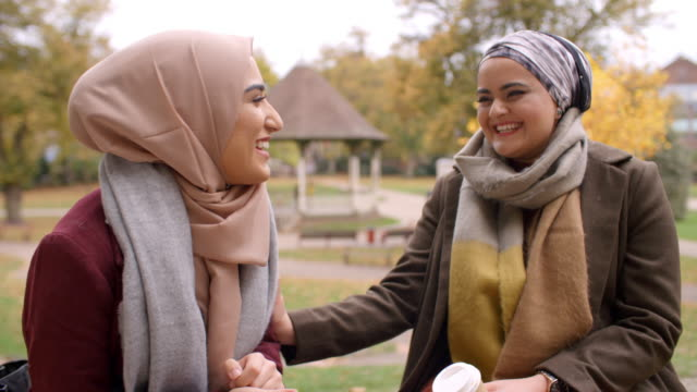 Two-British-Muslim-Women-Meeting-In-Urban-Park