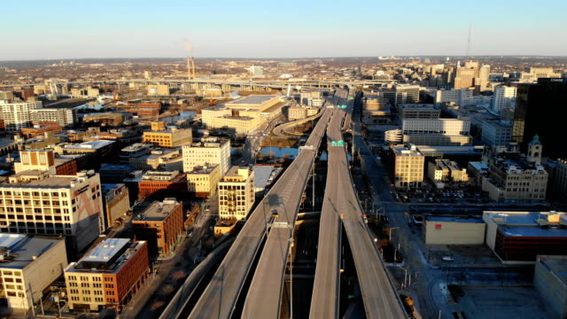 Aerial-view-of-american-city-at-dawn-High-rise-buildings-freeway-bay-Sunny-morning-Milwaukee-Wisconsin-USA