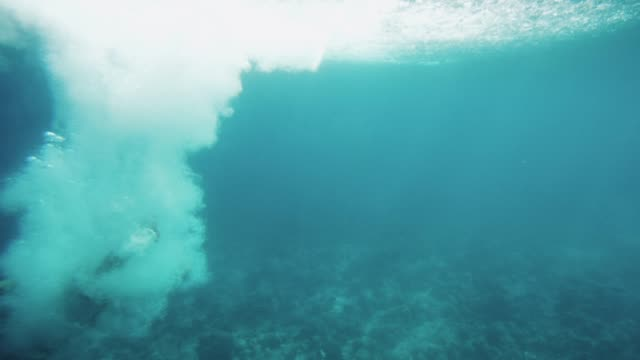 Underwater-Footage-of-Man-Jumping-into-Water-and-Swimming-Diving-in-the-Coral-Reefs-