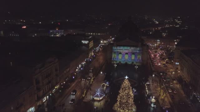 Lviv-Ukraine-Arial-shot-Lvov-Opera-house-Christmas-tree-Christmas-Fair-People-are-walking-around-the-city-center-Winter-Night-time