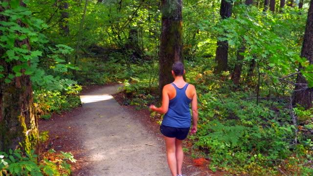 Optimistic-Cancer-Survivor-Woman-Walking-Down-Forest-Gravel-Path
