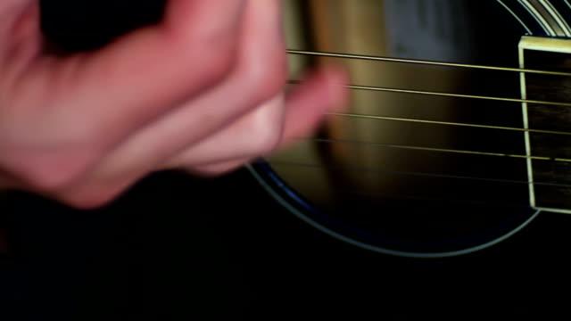 man-playing-Acoustic-guitar-close-up