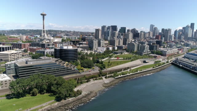 Helicopter-View-of-Downtown-Seattle-Buildings-in-Skyline-and-Waterfront-Piers-on-Sunny-Summer-Day