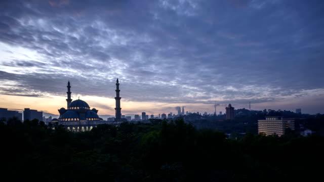 Sunrise-at-Federal-Mosque,-Kuala-Lumpur-with-silhouette-Kuala-Lumpur-city-skyline