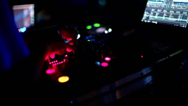 DJ-playing-music-in-a-large-outdoor-dance-party-with-people-dancing