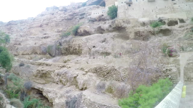 Panorama-of-Orthodox-Monastery-of-St-George-of-Choziba-in-Wadi-Qelt-in-the-eastern-West-Bank-Jerusalem-Israel-The-Wadi-Qelt-or-Nahal-Prat-mountain-area-in-the-north-of-the-Judean-Desert