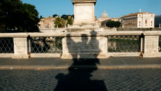 shadow-of-angel-on-the-bridge-of-castle-sant-angelo-Rome
