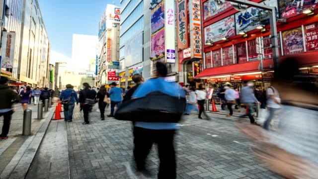 TOKYO-JAPAN-Pedestrians-walking-and-shopping-at-akihabara-district-
