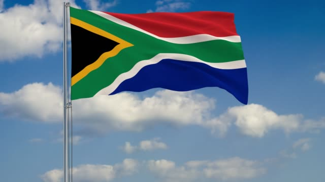 Flag-of-South-Africa-against-background-of-clouds-floating-on-the-blue-sky