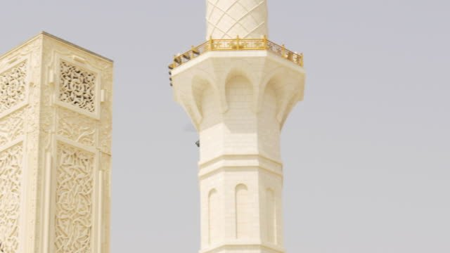 summer-day-time-mosque-helicopter-fly-4k-uae