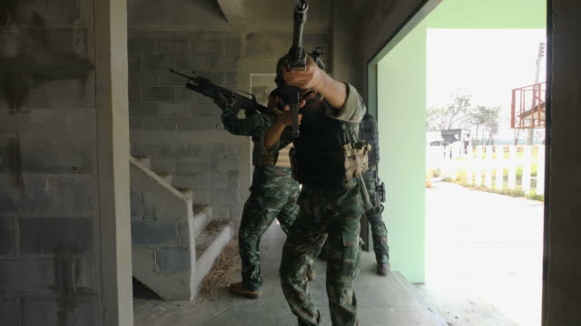 Squad-of-Fully-Equipped-and-Armed-Soldiers-Moving-Forward-to-Attack-and-Eliminate-Terrorist-Target-in-The-Building