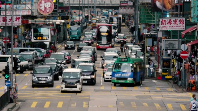 Time-lapse-of-busy-street-with-traffic-and-pedestrians-of-Mong-Kok-in-Hong-Kong-