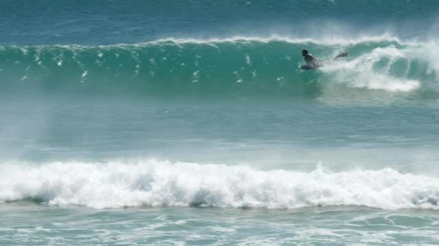 tracking-shot-of-a-kirra-bodyboard-surfer