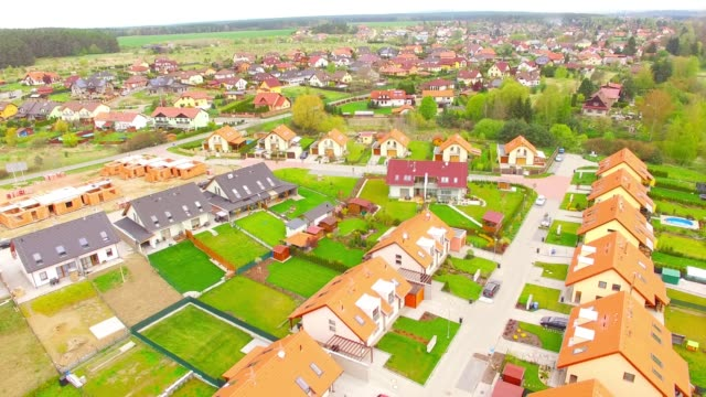 Camera-flight-over-new-family-houses-and-construction-site-in-suburban-district-Construction-industry-and-economic-growth-in-European-Union-