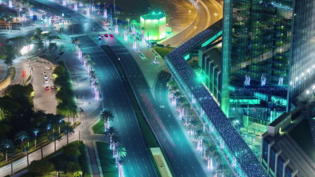 night-illumination-dubai-mall-traffic-street-roof-top-view-4k-time-lapse-united-arab-emirates