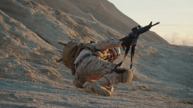 Soldier-is-Standing-up-after-He-Fell-Down-