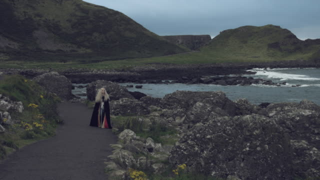 4k-Fantasy-Shot-on-Giant-s-Causeway-of-a-Queen-Walking-to-Camera