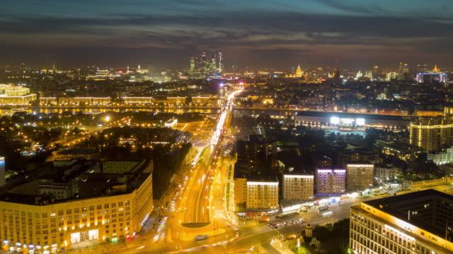 russia-night-illumination-sunset-sky-moscow-cityscape-traffic-street-panorama-4k-time-lapse