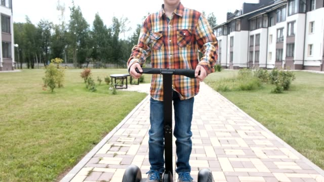 Boy-is-rolling-on-gyro-scooter-near-the-home-