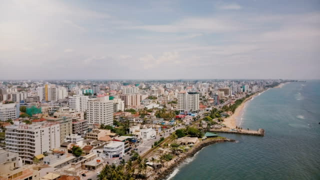 Drone-panning-left-over-amazing-coastline-and-buildings-of-Colombo-Sri-Lanka-Amazing-aerial-shot-of-Asian-architecture