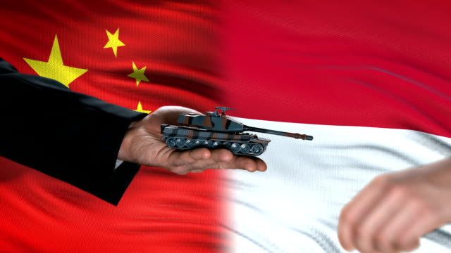 China-and-Indonesia-officials-exchanging-tank-for-money-flag-background-defense