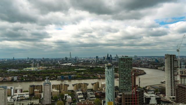 Aerial-Panorama-Of-Thames-River-And-Canary-Wharf-Business-District-In-London
