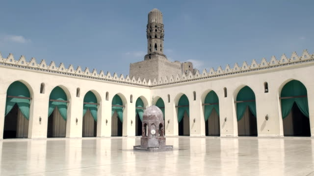 panning-shot-of-the-courtyard-of-the-al-hakim-mosque-in-cairo-egypt