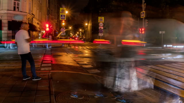people-have-fun-on-the-city-streets-on-a-summer-evening-on-Saturday-time-lapse