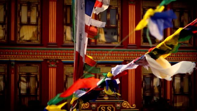 En-la-oración-flags-Boudhanath-por-estupa-Katmandú-Nepal