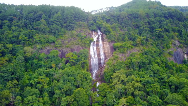 Close-approach-to-waterfall-aerial-view-from-drone-in-rain-forest-Siriphum-waterfall-in-Chiangmai-Thailand-