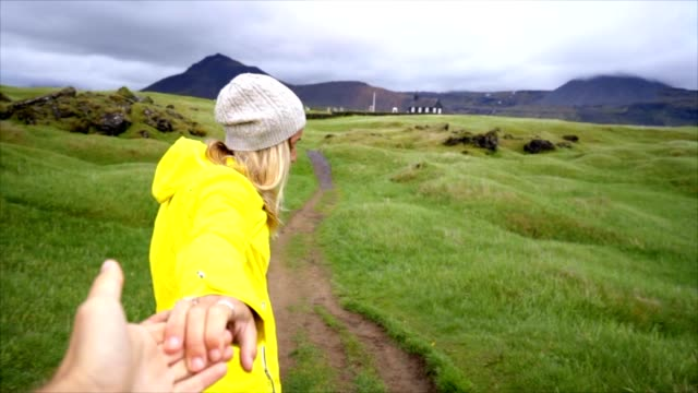 Follow-me-to-nature-girlfriend-leading-man-to-meadow