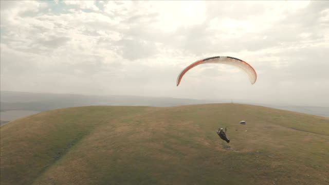 Athlete-paraglider-flies-on-his-paraglider-next-to-the-swallows-Follow-up-shooting-from-the-drone