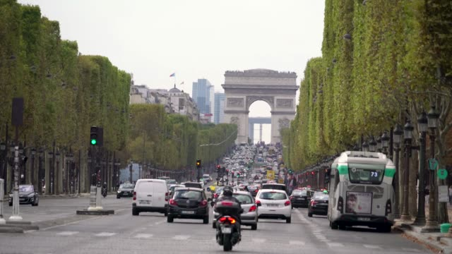 Traffic-jam-in-Champs-Elysees-avenue-in-Paris-France-in-a-grey-day