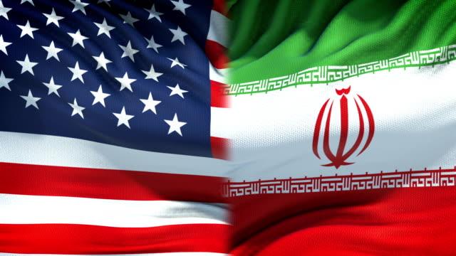 Fondo-de-banderas-de-Estados-Unidos-e-Irán-las-relaciones-diplomáticas-y-económicas