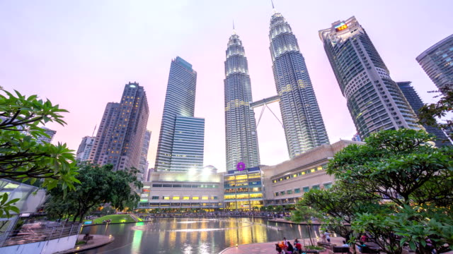 Dramatic-sunset-at-Kuala-Lumpur-City-Centre-fountain-park-where-sky-turn-pink-and-blue-as-the-sun-goes-down-