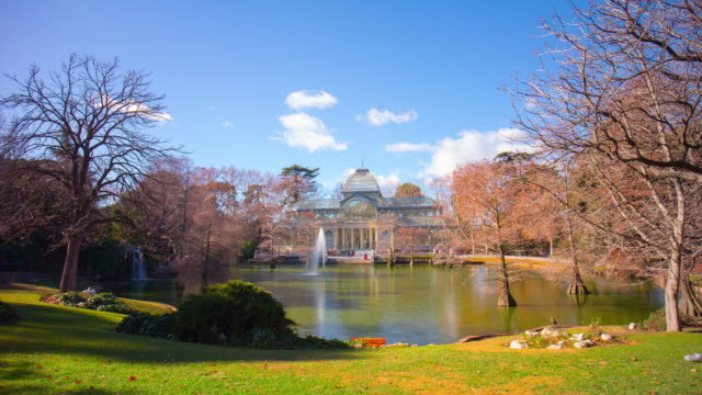 sunny-day-pond-panoramic-view-on-palacio-de-cristal-4k-time-lapse-spain