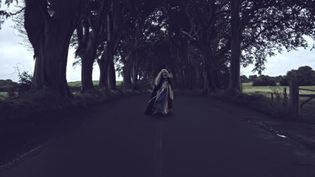 4k-Fantasy-Shot-in-Dark-Hedges-Queen-Walking-to-Camera