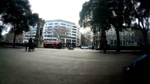 Tourist-pov-sitting-on-bench-on-Plaza-Catalunya