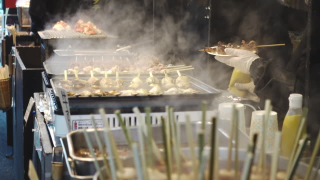 Cooking-food-in-a-Japanese-fish-market
