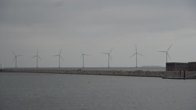 The-theme-is-net-power-generation-and-environmental-protection-A-number-of-wind-blades-wind-power-in-the-Baltic-Sea-in-Europe-Denmark-Copenhagen-in-winter
