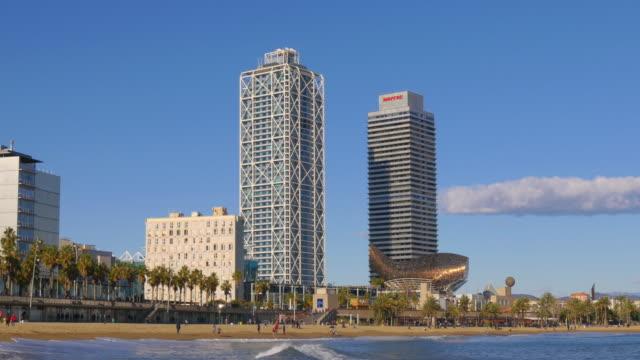 barcelona-sun-light-famous-beach-fish-sculpture-4k-spain