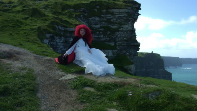 4k-Shot-of-a-Redhead-princess-on-Cliffs-of-Moher-View-in-Ireland
