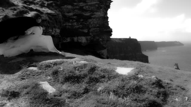 4k-Shot-of-a-Redhead-princess-on-Cliffs-of-Moher-View-in-Ireland-black-&-white