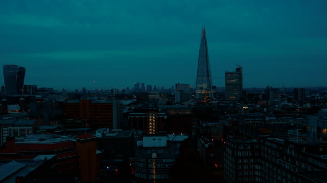 Panning-shot-of-the-Shard-and-south-London-skyline-during-the-blue-hour