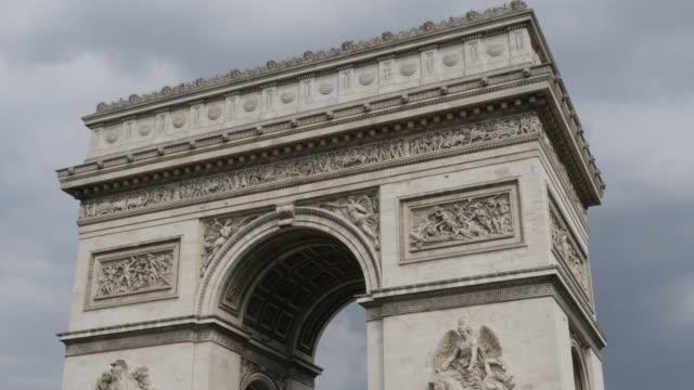 Arch-of-Triumph-in-Paris-France-highly-detailed-surface-in-front-of-cloudy-sky-4K-3840X2160-30fps-UHD-tilt-footage---World-famous-Arc-de-Triomphe-de-Etoile-slow-tilting-4K-2160p-UltraHD-video