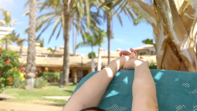 Video-of-relaxation-on-the-sunbed-in-tropical-resort-in-4K-in-60fps